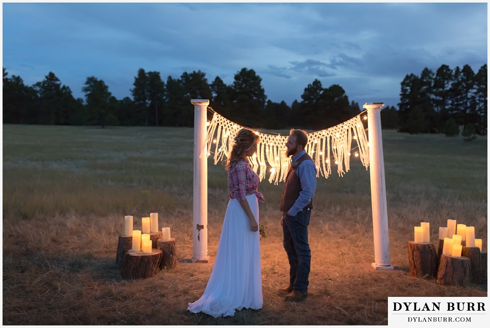 boho backyard colorado wedding bride and groom stand with each other