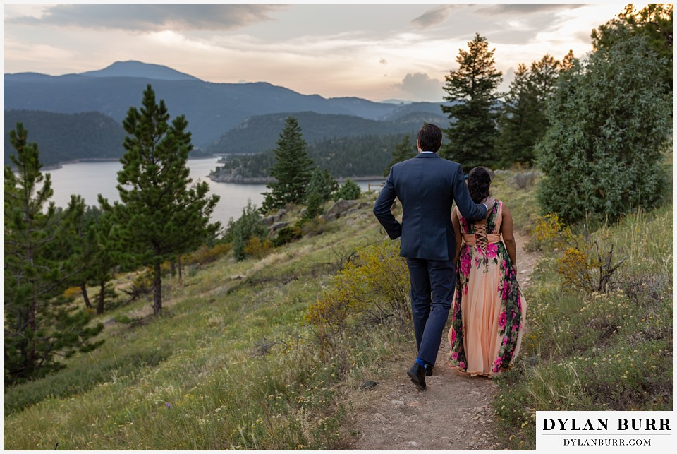 boulder colorado engagement session in the mountains walking on trail towards lake