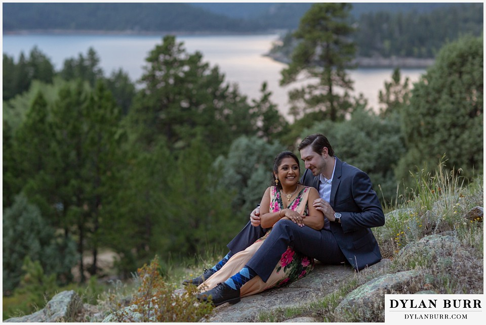 boulder colorado engagement session in the mountains couple sitting on rock
