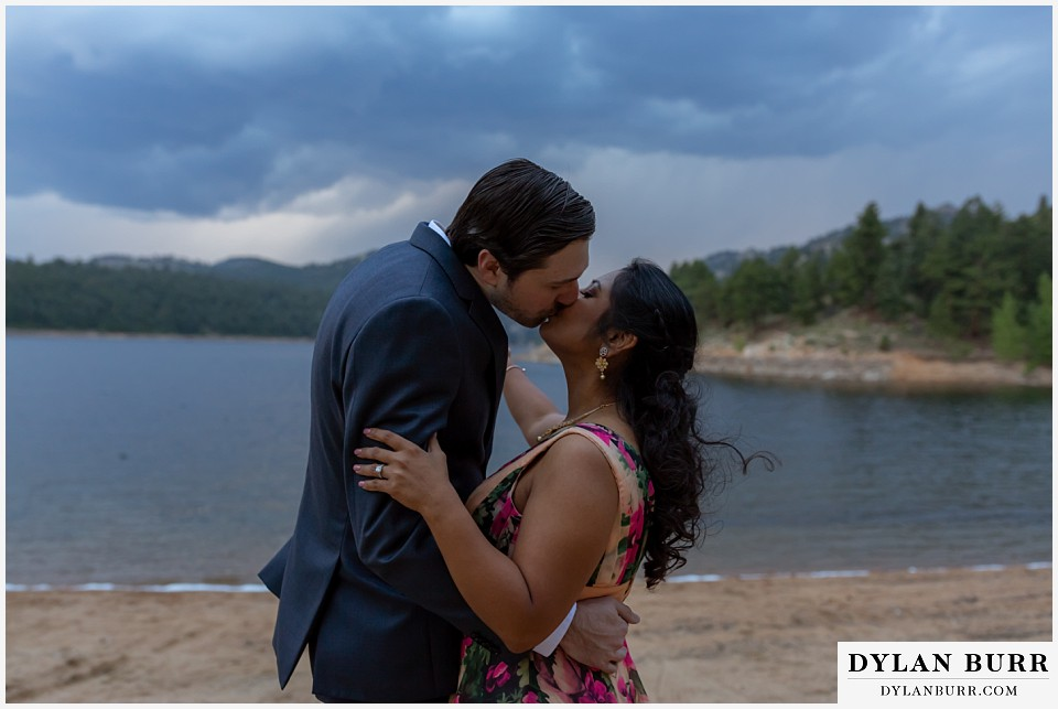 boulder colorado engagement session in the mountains couple kissing by lake