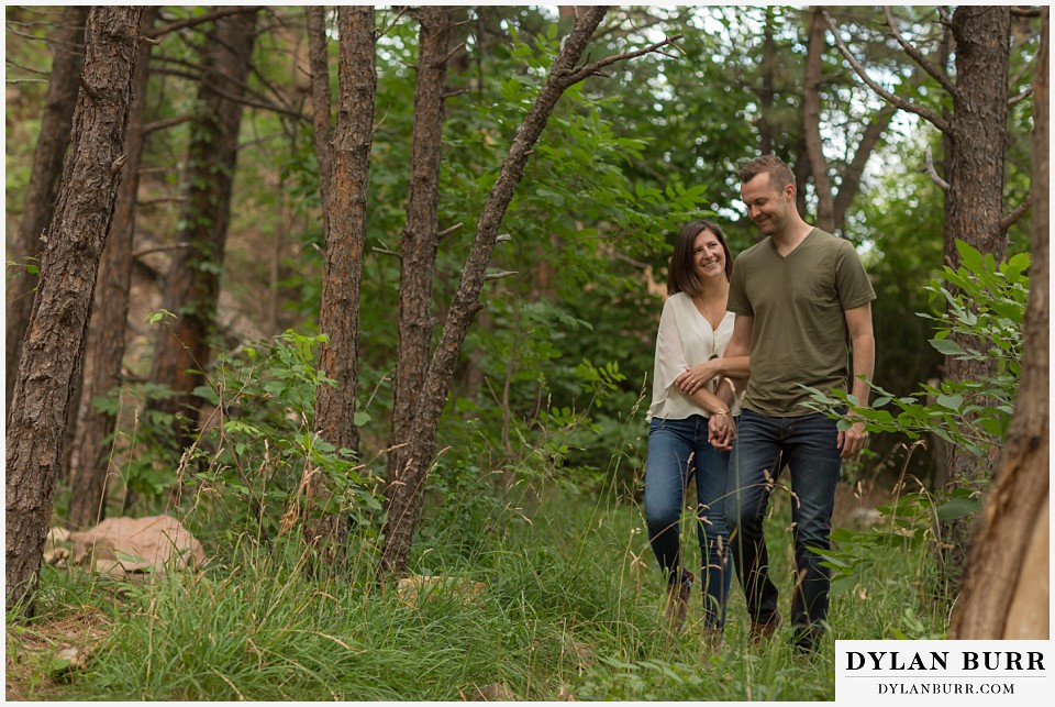 boulder wedding engagement session walking in pine trees