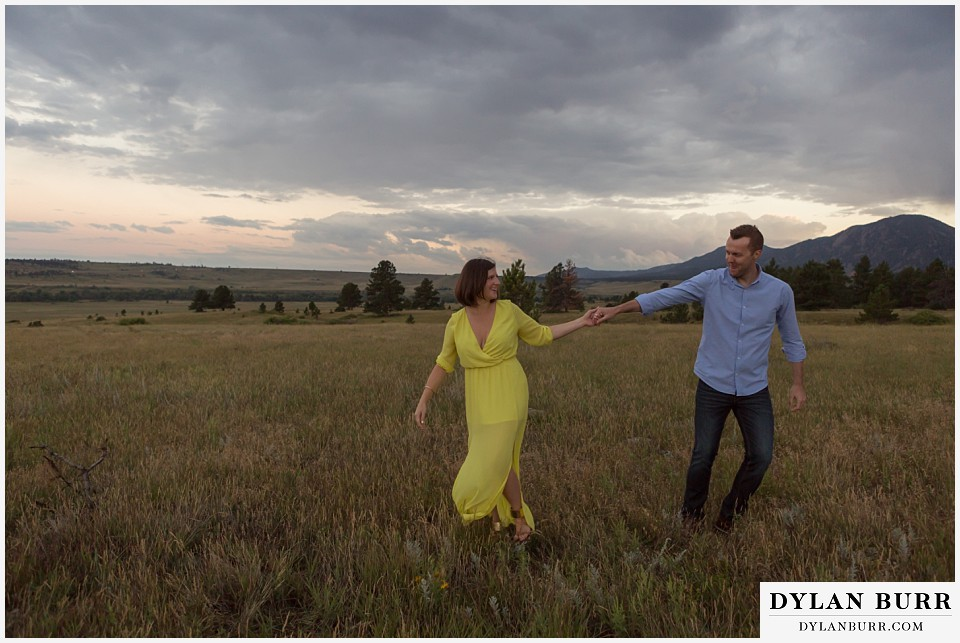 boulder wedding engagement session dacing in field