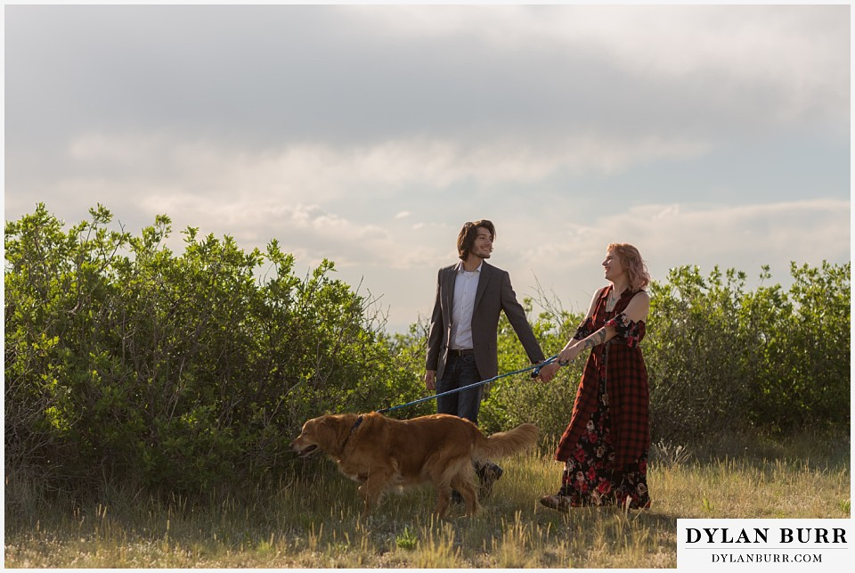 castle rock colorado engagement session walking with golden retriever