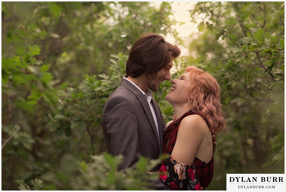 castle rock colorado engagement session laughing in the oak trees
