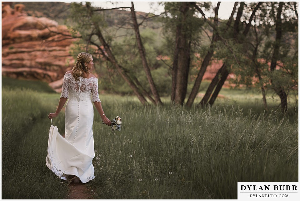 colorado bridal portrait session lace shrug walking in a field