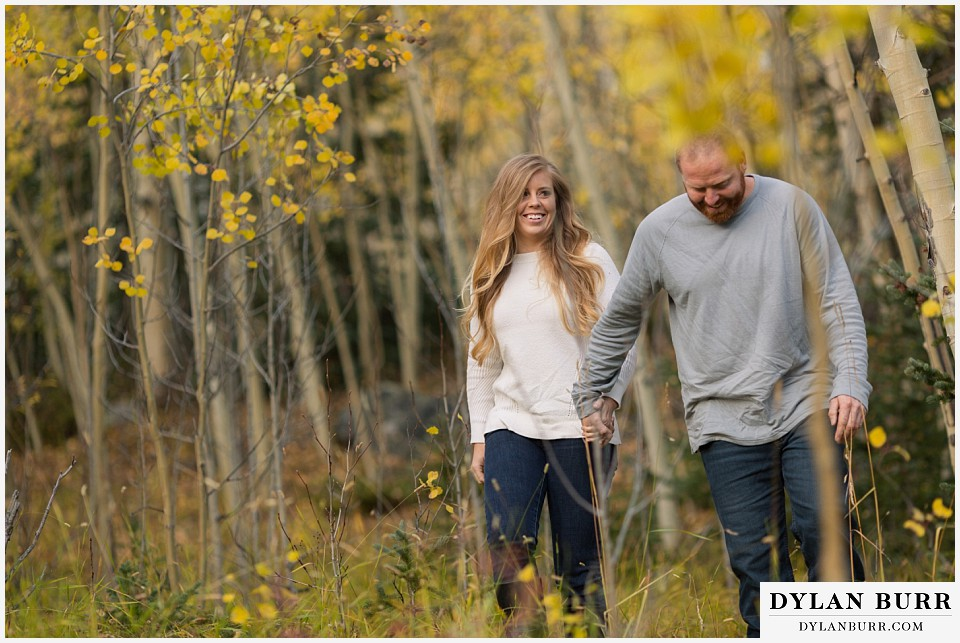 colorado mountain engagement session walking in the aspen trees