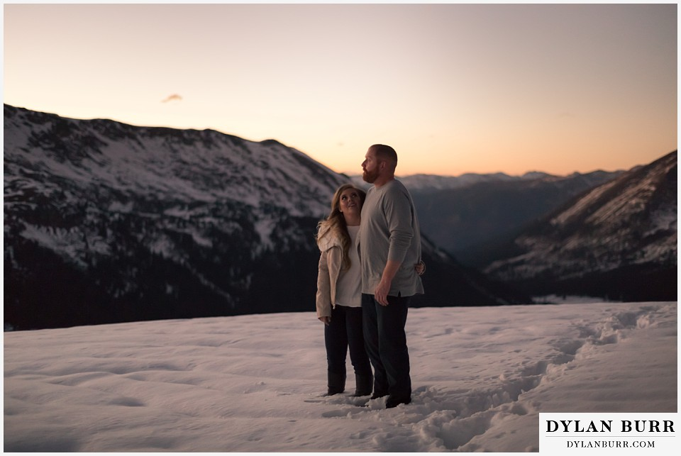 colorado mountain engagement session knee deep of snow at the mountain pass