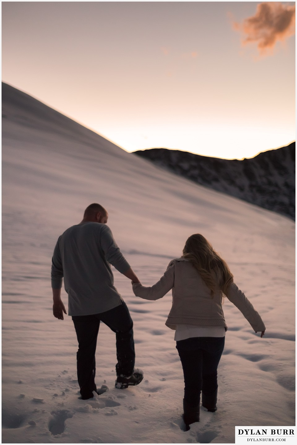 colorado mountain engagement session walking holding hands in deep mountain snow