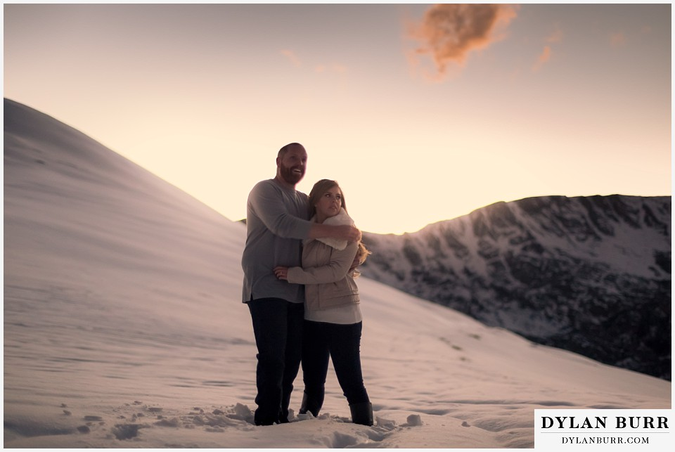 colorado mountain engagement session holding eachother and enjoying the sunset