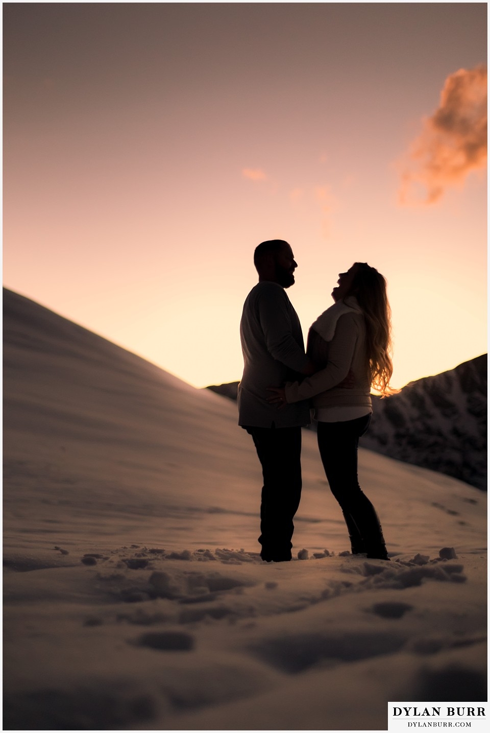 colorado mountain engagement session laughing in silhouette