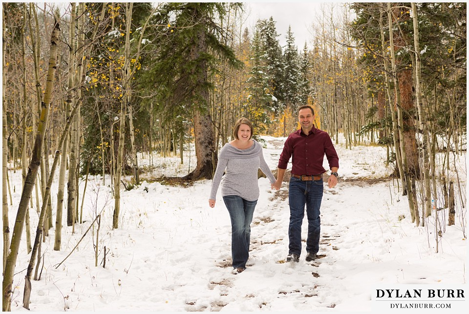 colorado mountain engagement session walking in snow