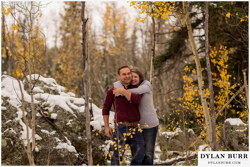colorado mountain engagement session yellow aspen tree leaves snow