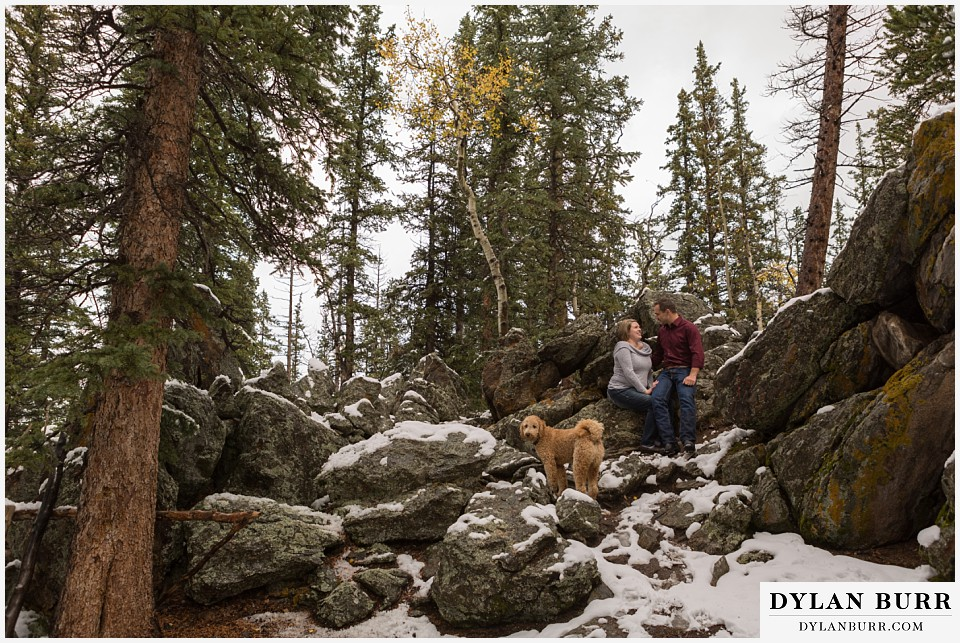 colorado mountain engagement session snow on large mountain rocks