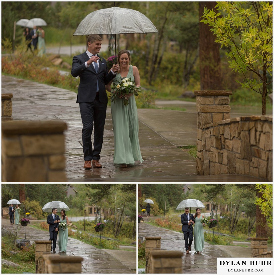 della terra wedding estes park colorado mountain wedding bridal party with umbrellas entering ceremony site