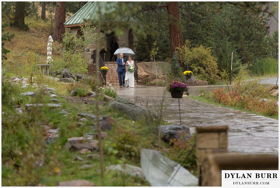 della terra wedding estes park colorado mountain wedding bride walking to ceremony site