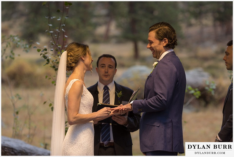 della terra wedding estes park colorado mountain wedding exchanging rings