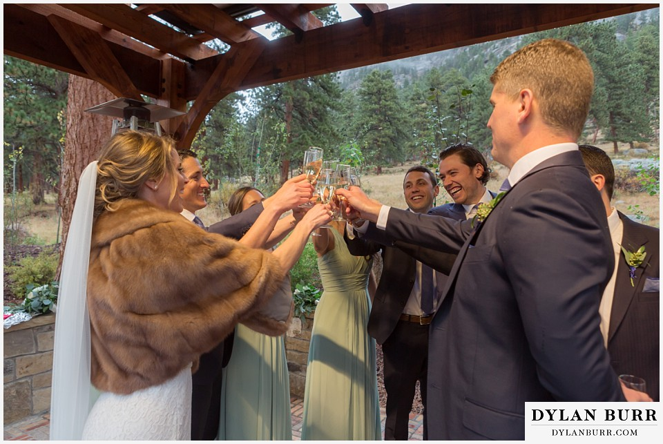della terra wedding estes park colorado mountain wedding bridal party champagne toast