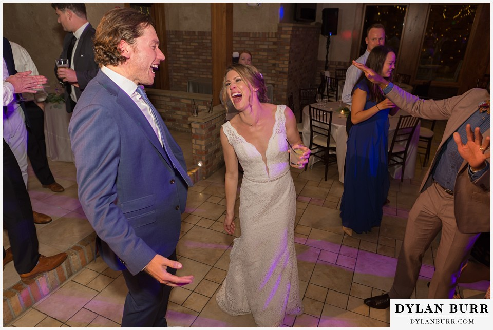 della terra wedding estes park colorado mountain wedding couple singing together