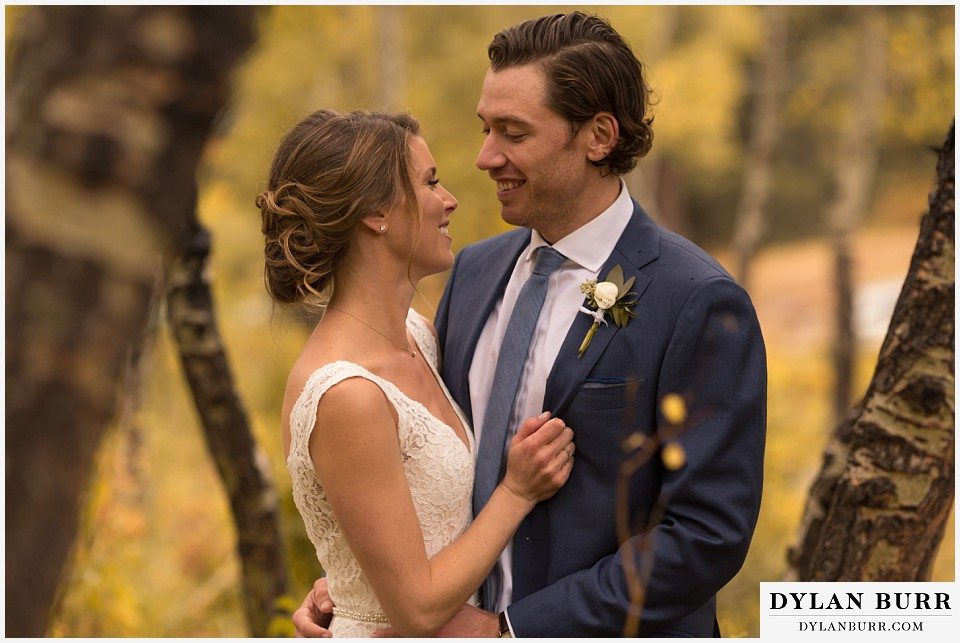 della terra wedding estes park colorado mountain wedding couple in fall aspen trees
