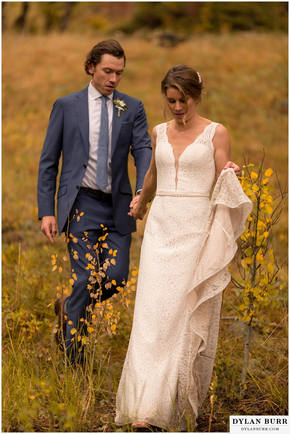 della terra wedding estes park colorado mountain wedding walking in fall colors