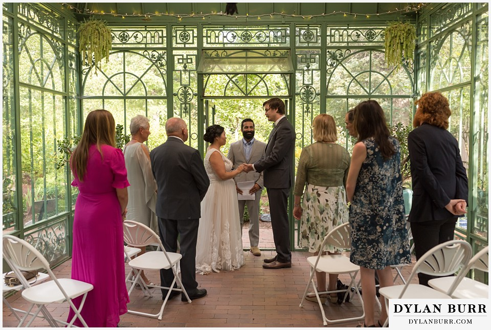 denver botanic gardens wedding colorado woodland mosaic bride groom holding hands saying vows during wedding ceremony