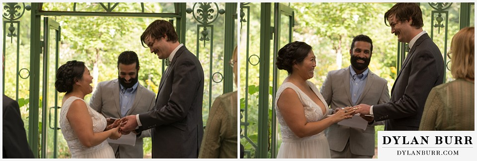denver botanic gardens wedding colorado woodland mosaic bride groom exchanging rings during wedding ceremony