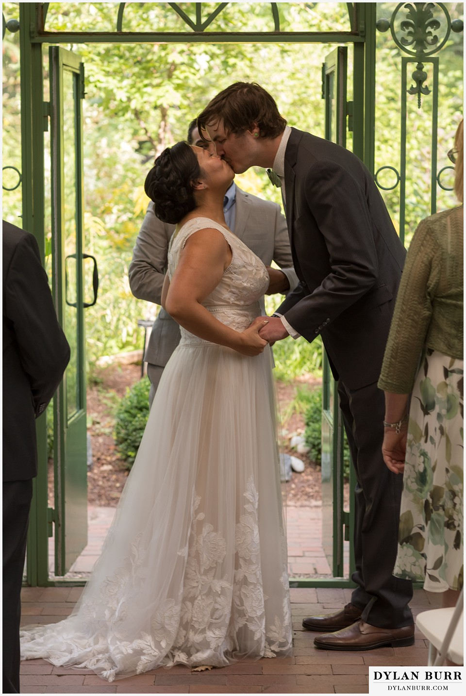 denver botanic gardens wedding colorado woodland mosaic bride groom first kiss during wedding ceremony
