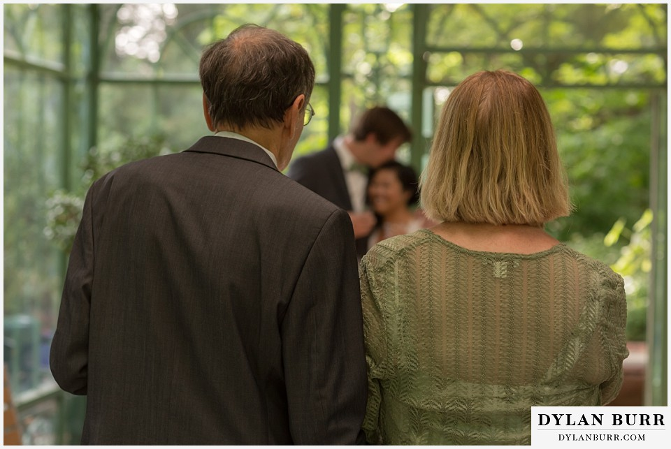 denver botanic gardens wedding colorado woodland mosaic grooms parents look on at bride and groom