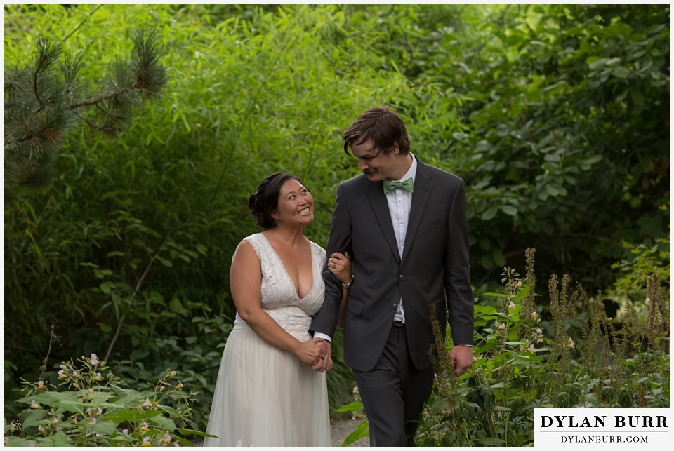 denver botanic gardens wedding colorado woodland mosaic bride groom walking hand in hand