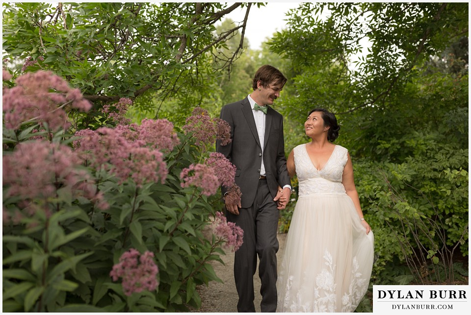 denver botanic gardens wedding colorado woodland mosaic bride groom walking together in park