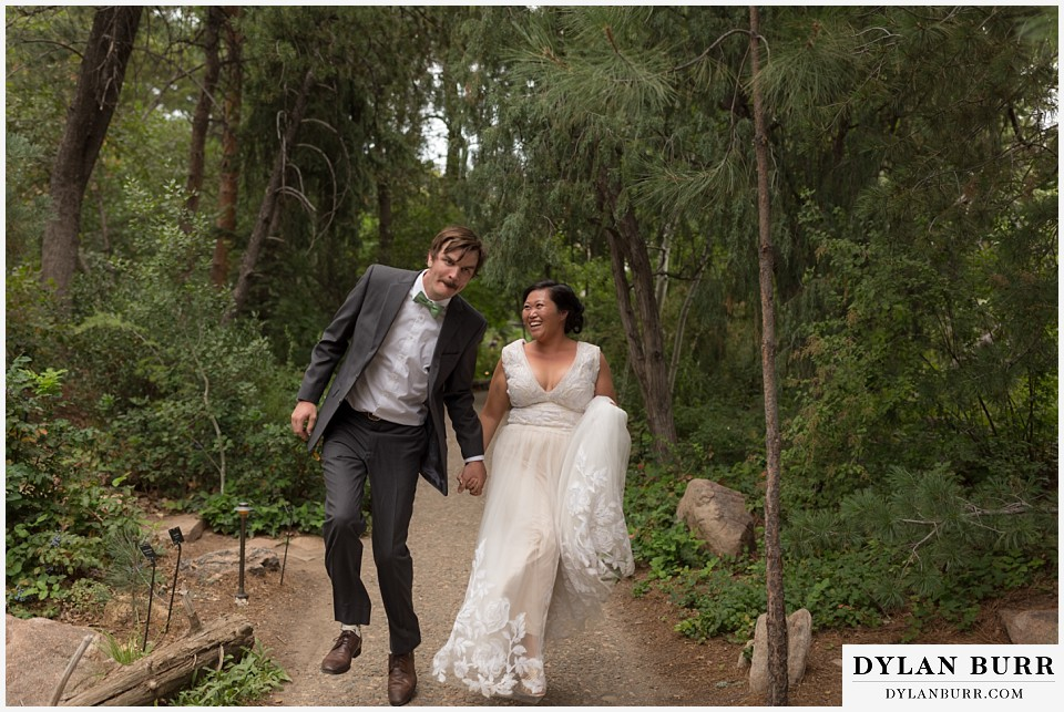 denver botanic gardens wedding colorado woodland mosaic bride groom skipping on path