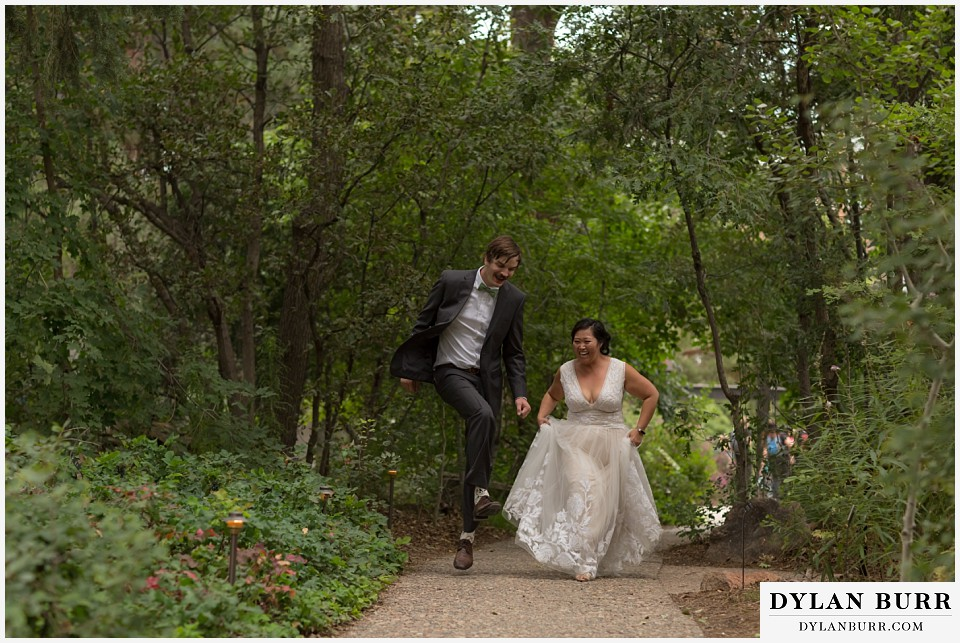 denver botanic gardens wedding colorado woodland mosaic bride groom trying to skip together