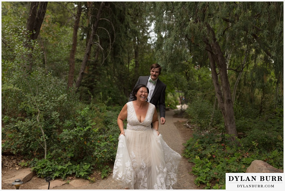denver botanic gardens wedding colorado woodland mosaic bride groom skipping and laughing