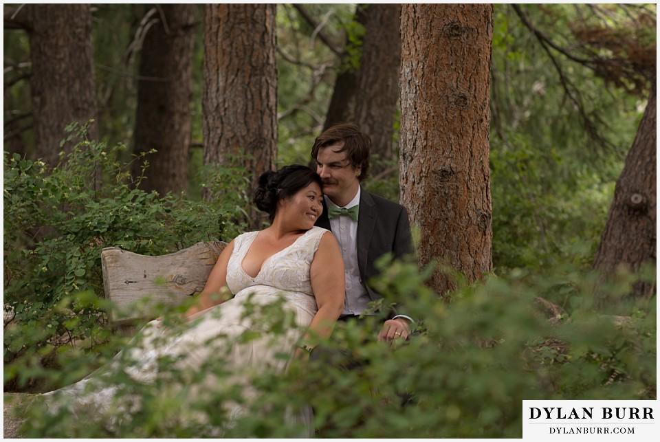 denver botanic gardens wedding colorado woodland mosaic bride groom sitting on bench