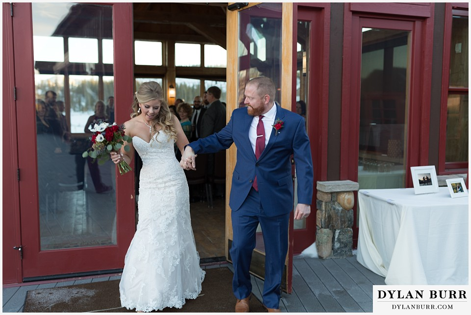 devils thumb ranch wedding in winter ceremony timber house happy dance