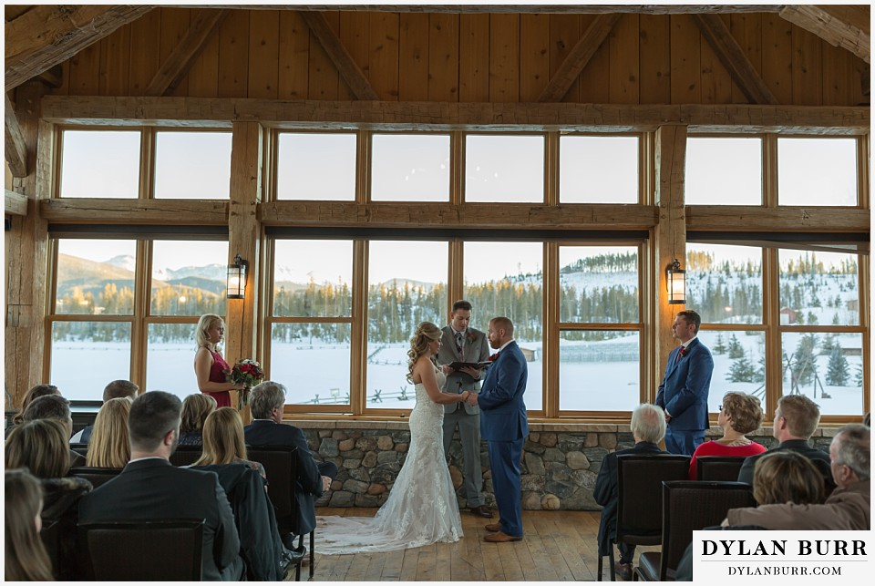 devils thumb ranch wedding in winter/devils thumb ranch wedding in winter ceremony timber house mountain views rings