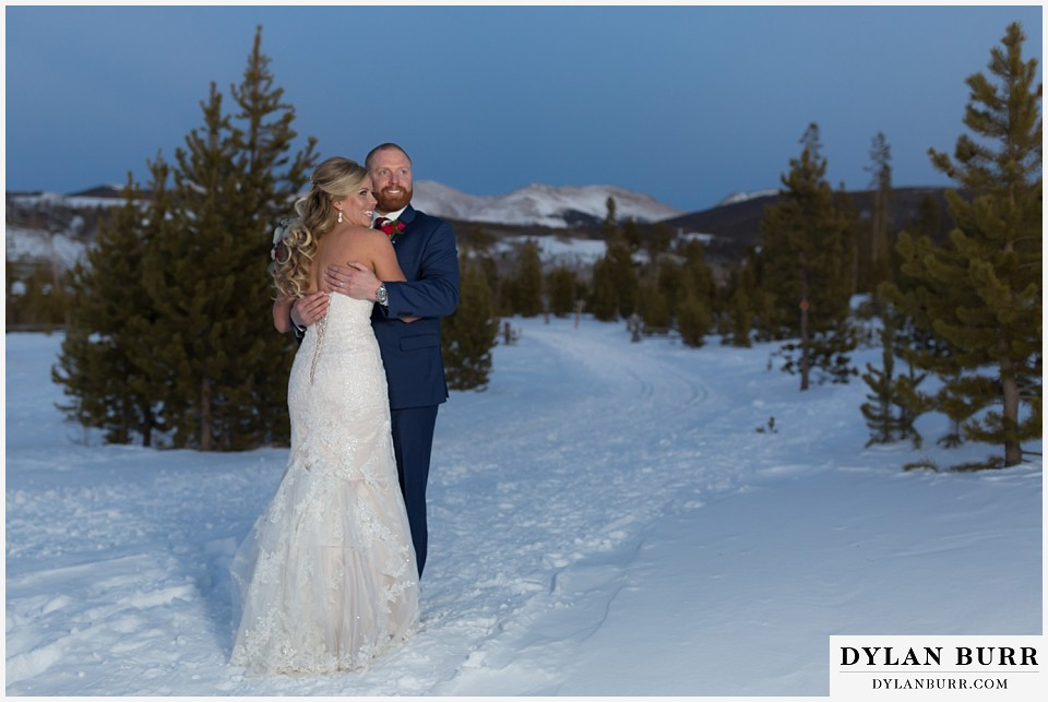 devils thumb ranch wedding in winter couple high mountain views in snow