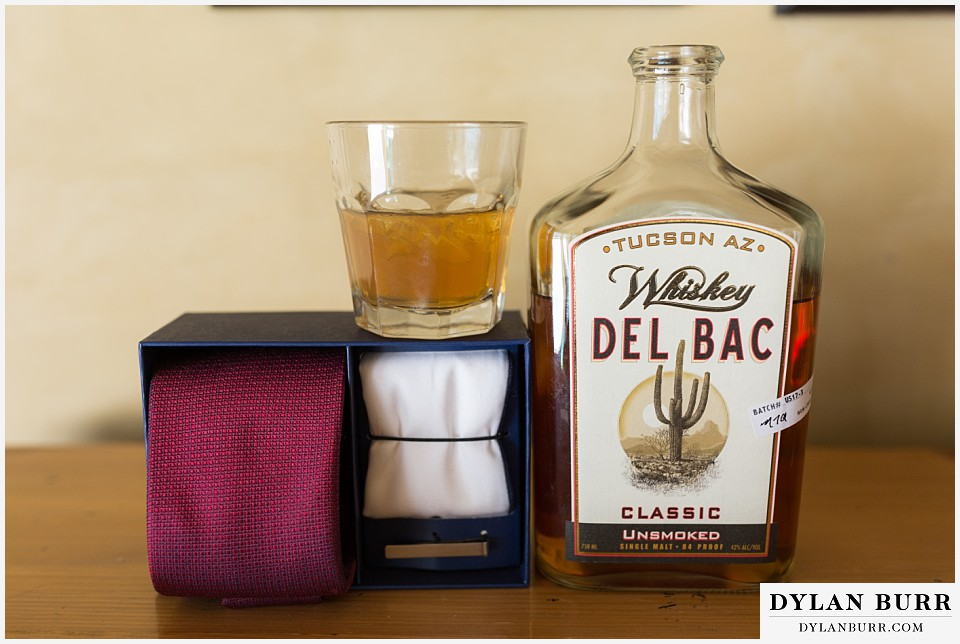 devils thumb ranch wedding in winter grooms details whiskey
