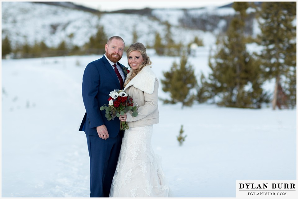 devils thumb ranch wedding in winter wedding couple mountains