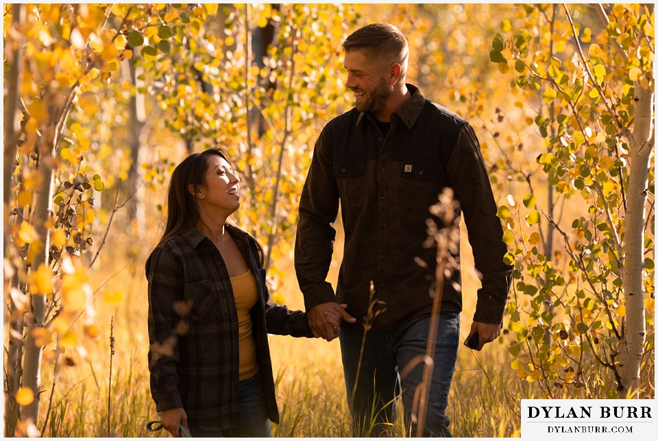 engagement photos golden colorado photographer couple laughing together