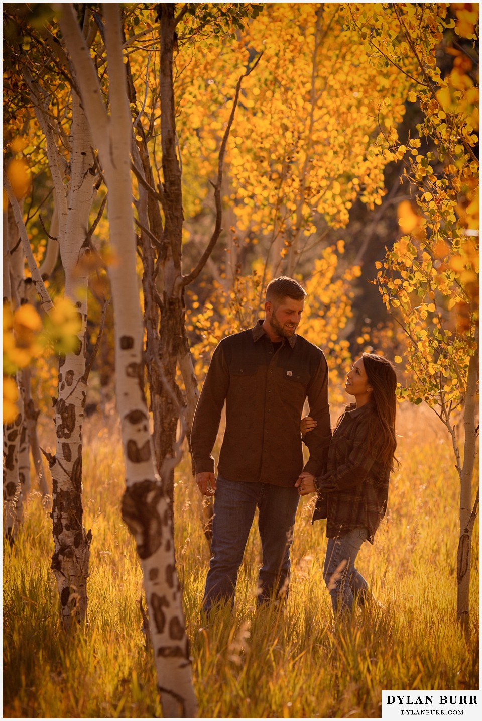 engagement photos golden colorado photographer couple walking together in the mountain during fall in colorado