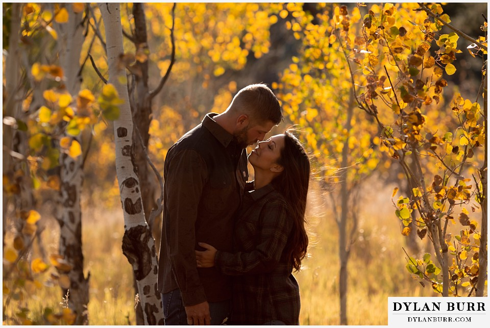 engagement photos golden colorado photographer fall in colorado mountains yellow aspen leaves