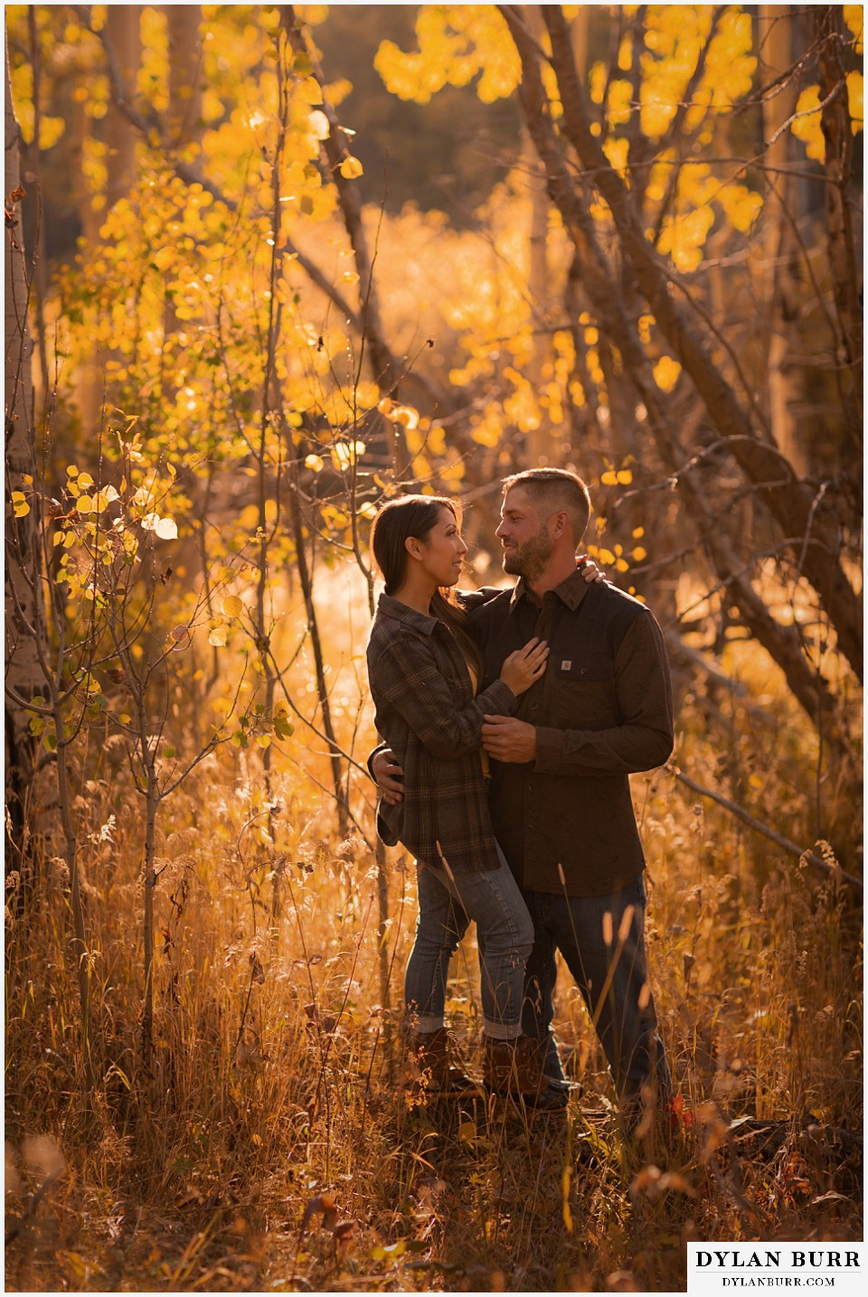 engagement photos golden colorado photographer couple standing together in aspen trees during fall in colorado