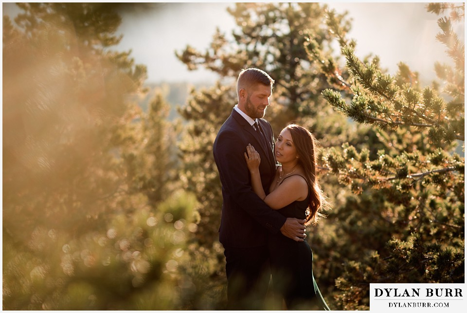 engagement photos golden colorado photographer couple standing together in pine trees