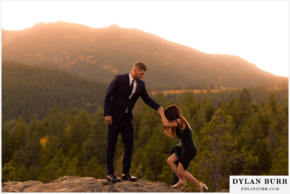 engagement photos golden colorado photographer couple climbing up rock