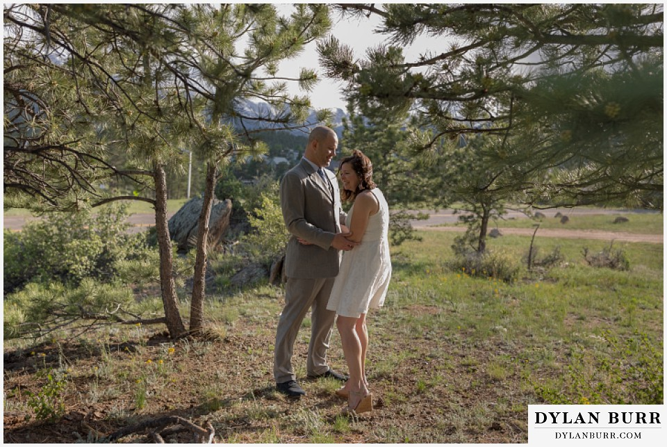 rocky mountain estes park engagement session laughing in pine trees