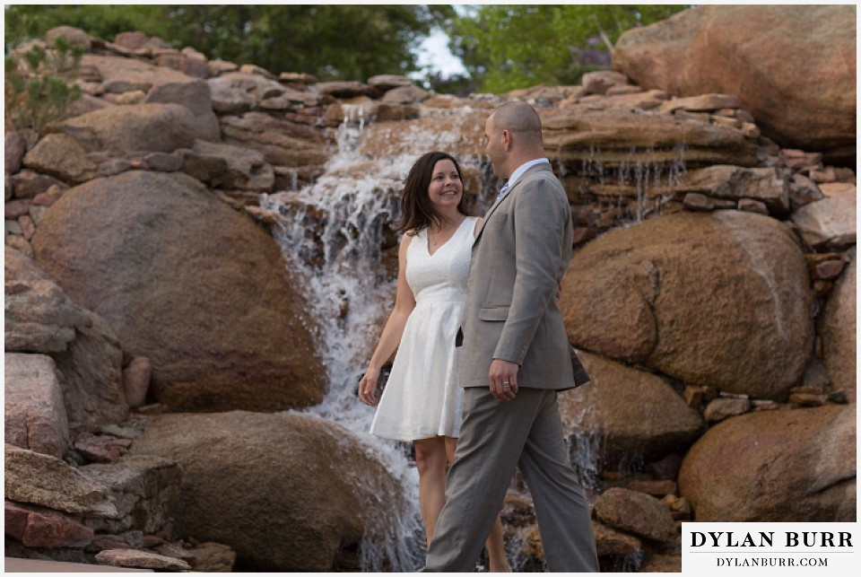 rocky mountain estes park engagement session Stanley Hotel waterfall