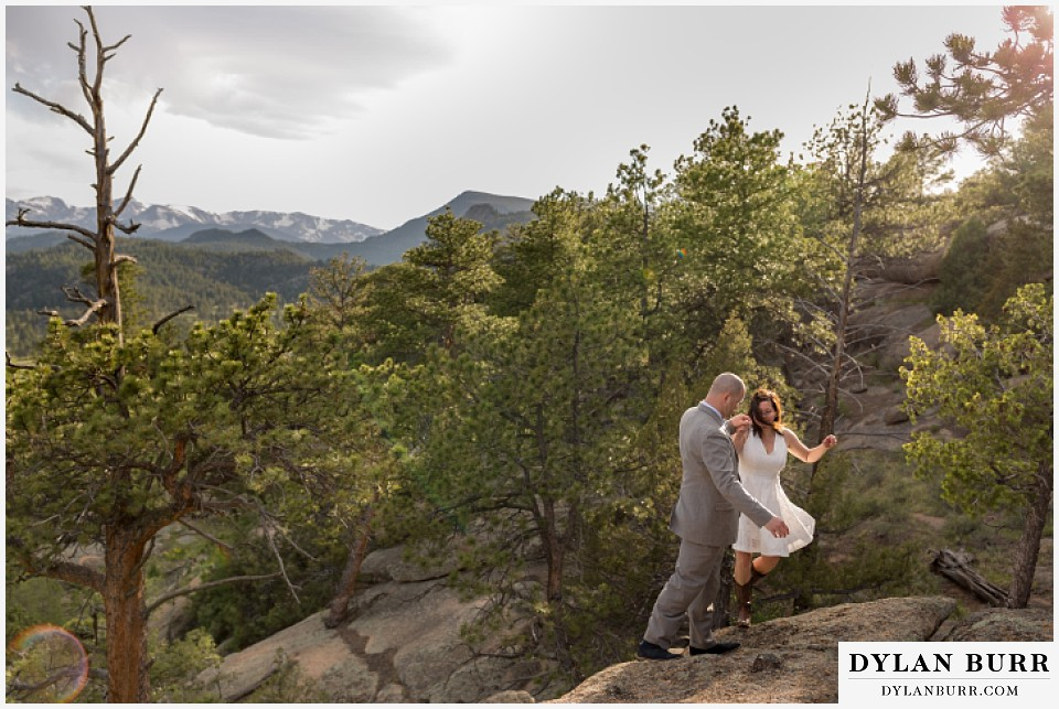 rocky mountain estes park engagement session rock climbing in white dress
