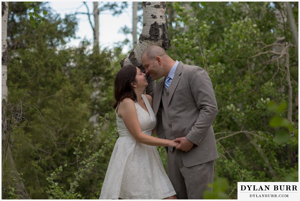 rocky mountain estes park engagement session kissing near aspen trees
