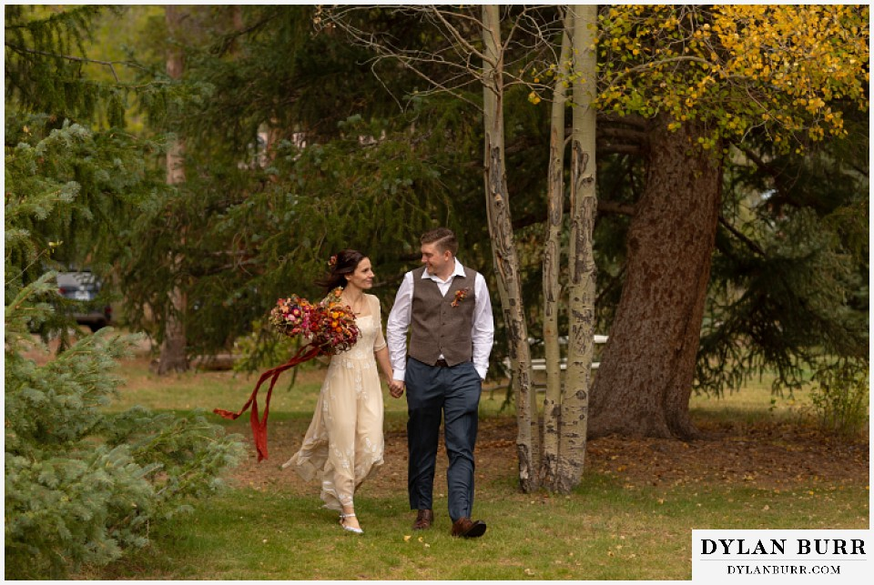 grand lake wedding elopement bride and groom walking through trees